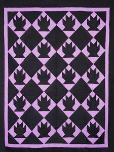 An Amish Pieced & Quilted Cotton Coverlet, Indiana or Ohio, circa 1910