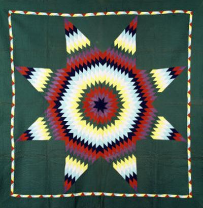An Amish Star of Bethlehem Coverlet, Pennsylvania, Pieced and Quilted Cotton, Circa 1930