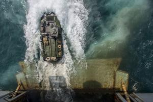 An Amphibious Assault Vehicle Exits the Well Deck of USS Bataan