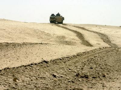 An Amphibious Assault Vehicle Rolls Through a Desert Field North of Fallujah-Stocktrek Images-Photographic Print