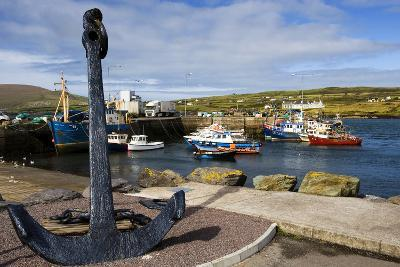 An Anchor Stands on the Shore Overlooking Fishing Boats in Portmagee-Chris Hill-Photographic Print