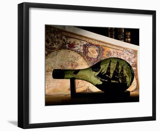An Antique Map Provides the Backdrop for a Ship in a Bottle-Todd Gipstein-Framed Photographic Print