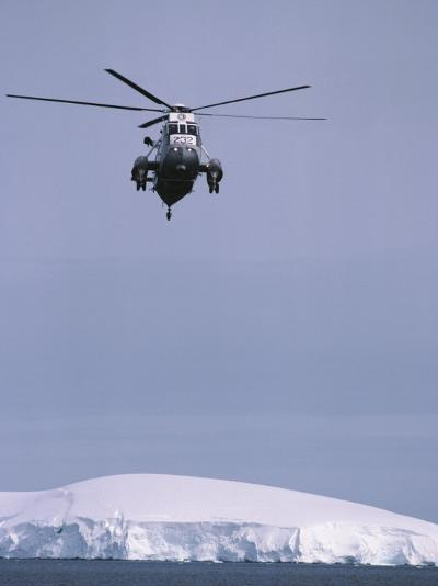 An Argentine Helicopter Flies over Anvers Island-Gordon Wiltsie-Photographic Print