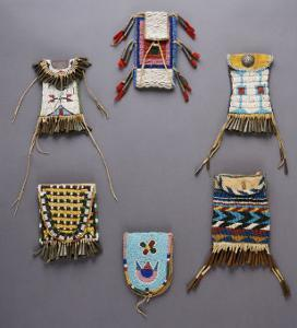 An Assortment of Kiowa, Sioux, Cheyenne, Crow, and Apache Beaded Hide Belt Pouches