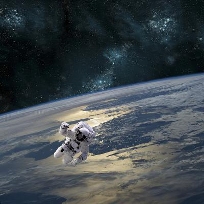 An Astronaut Floating Above Earth-Stocktrek Images-Photographic Print