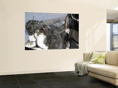 An Astronaut on the Starboard Side of the Cargo Bay of Space Shuttle Atlantis--Wall Mural