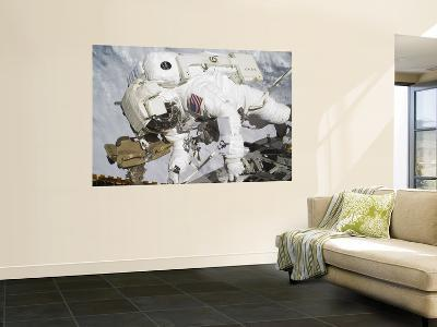 An Astronaut Participates in a Session of Extravehicular Activity--Wall Mural