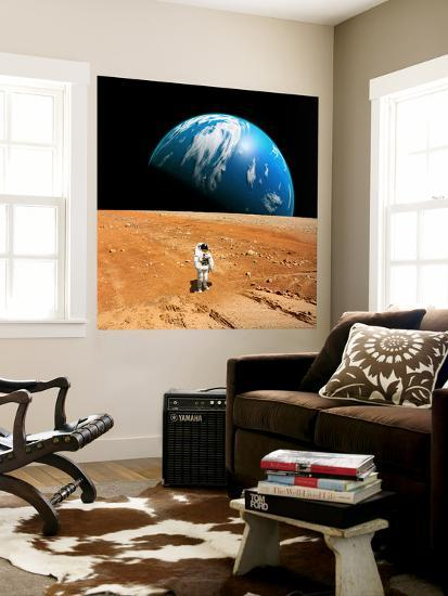 An Astronaut Standing on a Barren World with Planet Rising in Background-Stocktrek Images-Wall Mural