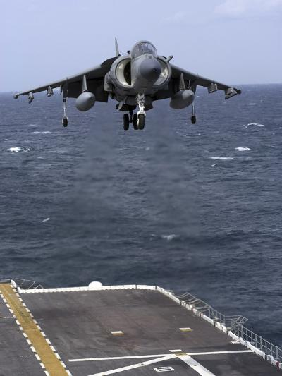 An AV-8B Harrier II Prepares to Land on the Flight Deck of USS Nassau-Stocktrek Images-Photographic Print