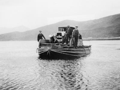 An Early Ferry Transporting a Car across a Lake--Photographic Print