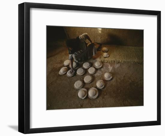 An Egyptian Woman Makes Loaves of Bread in a Traditional Manner-Kenneth Garrett-Framed Photographic Print