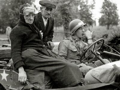 An Elderly Couple Sitting in a Jeep Driven by a Military Police--Photographic Print