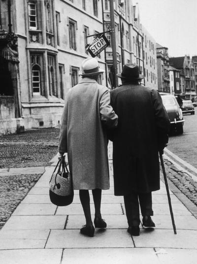 An Elderly Couple Walking Down the Street, Arm in Arm-Henry Grant-Photographic Print