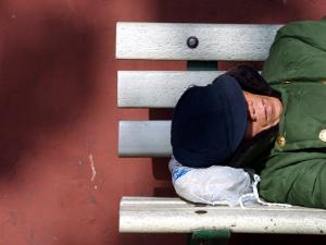 An Elderly Man Sleeps on a Bench Near Beijing's Tiananmen Square
