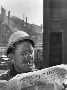 An Electrician Reads 'The Wall Street Journal' to Check His Stock Market Investments