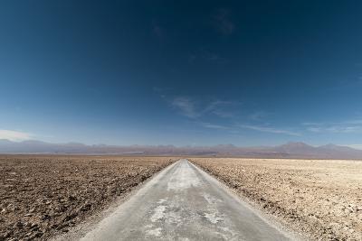 An Empty Road Through a Salt Flat in the Salar De Atacama-Sergio Pitamitz-Photographic Print