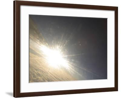 An Expanse of Sky Above Fluffy Clouds with a Bright Sun Shining--Framed Photographic Print
