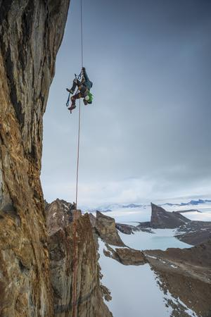 An expedition team member hauls himself up Bertha's Tower in remote Queen Maud Land.-Cory Richards-Photographic Print