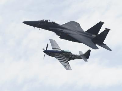 An F-15 Eagle and the P-51 Mustang Fly in Formation-Raul Touzon-Photographic Print