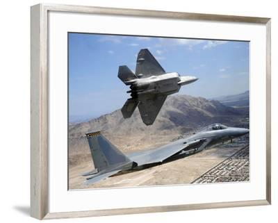 An F-22 Raptor Aircraft Turns Away While An F-15 Eagle Flies the Approach Over Nevada-Stocktrek Images-Framed Photographic Print