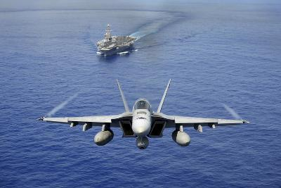 An F-A-18E Super Hornet Flying Above USS John C. Stennis--Photographic Print