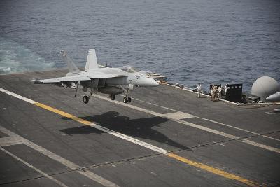 An F-A-18E Super Hornet Lands Aboard the Aircraft Carrier USS Nimitz--Photographic Print
