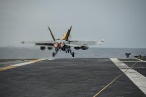 An F-A-18E Super Hornet Takes Off from the Flight Deck of USS George Washington