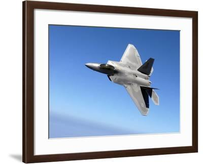 An F/A-22 Raptor Banks During a Training Sortie-Stocktrek Images-Framed Photographic Print