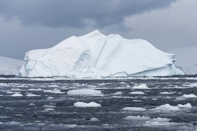 An Iceberg Floats in Fournier Bay, Antarctica-Jeff Mauritzen-Photographic Print
