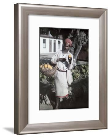 An Indian Man Sells Fruit on Durban Streets-Melville Chater-Framed Photographic Print
