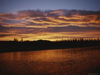 An Intense Sunset Colors Clouds and the Water of the Mackenzie River-Raymond Gehman-Photographic Print