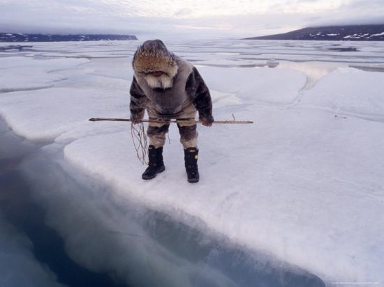 An Inuit Hunter Waits For Seals on an Ice Floe-Gordon Wiltsie-Photographic Print