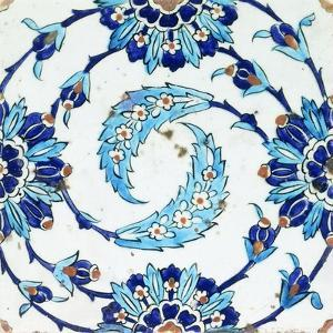 An Iznik Pottery Tile, with a Spiralling Floral Motif, Early 17th Century