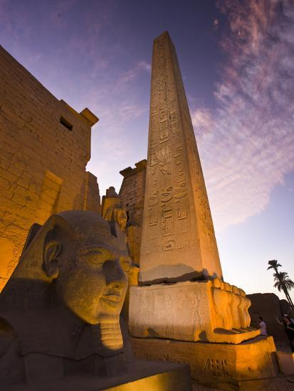 An Obelisk and Sphinx Head at the Entrance to Luxor Temple-Michael Melford-Photographic Print