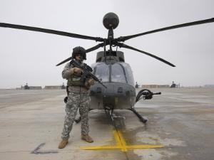 An Oh-58D Kiowa Warrior Pilot Stands Beside His Aircraft
