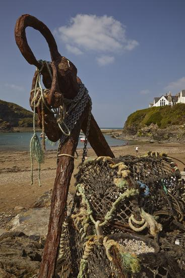 An Old Anchor Next to Crab Pots Piled Up Beside the Harbor in Port Isaac, Near Padstow, Cornwall-Nigel Hicks-Photographic Print