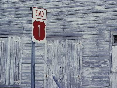 An Old Barn of Weathered Wood and a Road Sign-Medford Taylor-Photographic Print