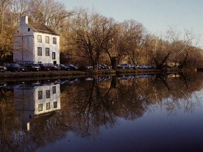 An Old Lockhouse Reflected in the C & O Canal-Stephen St^ John-Photographic Print