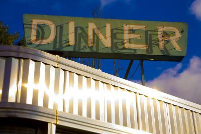 An Old Neon Diner Sign Above Glistening Reflective Aluminum Siding-Stephen St^ John-Photographic Print