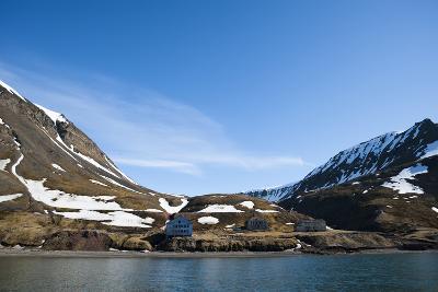 An Old Settlement Nestled Among Cliffs Near Longyearbyen on the Bay of Adventfjorden-Sergio Pitamitz-Photographic Print