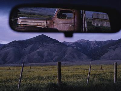 An Old Truck and Barn are Reflected in a Rear-View Mirror-Joel Sartore-Photographic Print