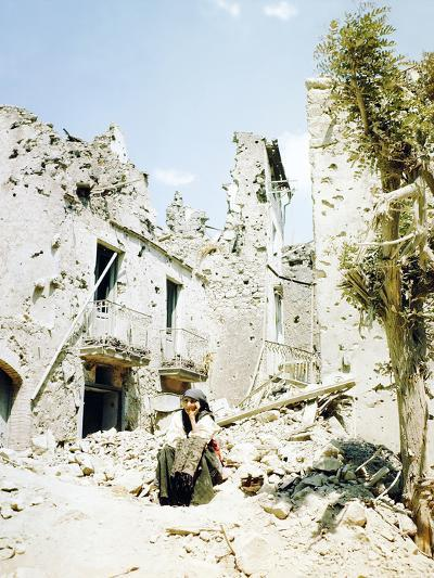 An Old Woman Sits in Front of Her Demolished Home in Castelforte--Photographic Print