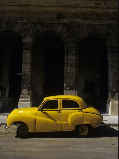 An Old Yellow Car Sits at the Curb in Old Havana Photographic Print by  Kenneth Ginn | Art com