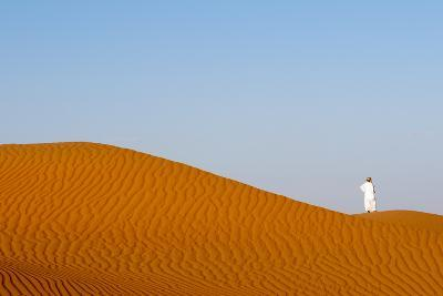 An Omani Man Walking Along the Crest of a Sand Dune at Sunset-Sergio Pitamitz-Photographic Print