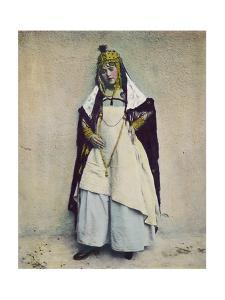 An Ouled Nail Tribal Cafe Dancer Bejeweled in Gold and Silver Coins
