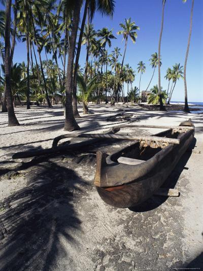 An Outrigger Canoe Rests on a Beach-Heather Perry-Photographic Print