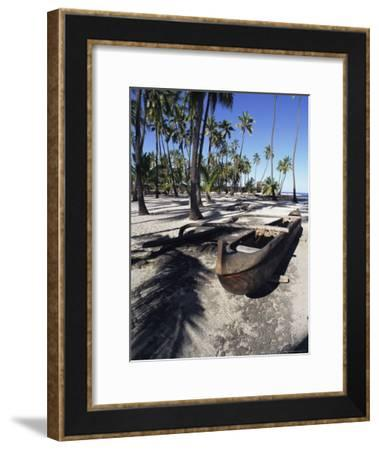 An Outrigger Canoe Rests on a Beach-Heather Perry-Framed Photographic Print