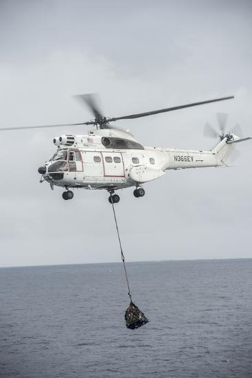 An SA-330 Puma Transport Helicopter Moves Cargo During a Vertical Replenishment--Photographic Print