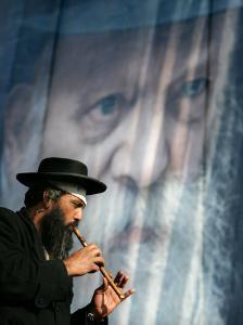 An Ultra-Orthodox Jewish Man Plays a Flute
