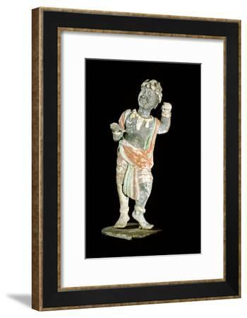 An unglazed and painted pottery model of a curly-headed and bejewelled youth-Werner Forman-Framed Giclee Print